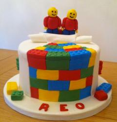 Colorful kids lego cake with twins lego figures.JPG