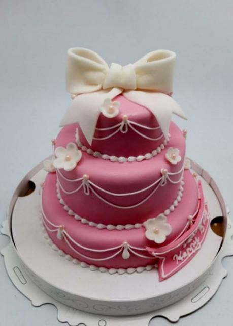 Pink 3 Tier Birthday Cake For Girl With White Bow On TopJPG