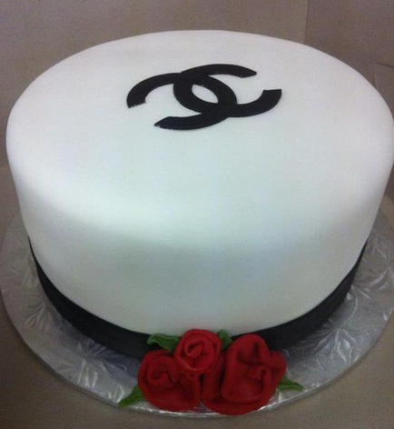 Smooth white Chanel cake with Chanel black logo and cake red roses.PNG