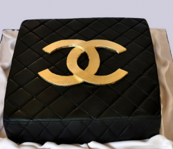 Square black Chanel cake with gold logo cake decor.PNG