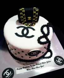 White black Chanel cake with black pearls and black Chanel purse cake topper.PNG