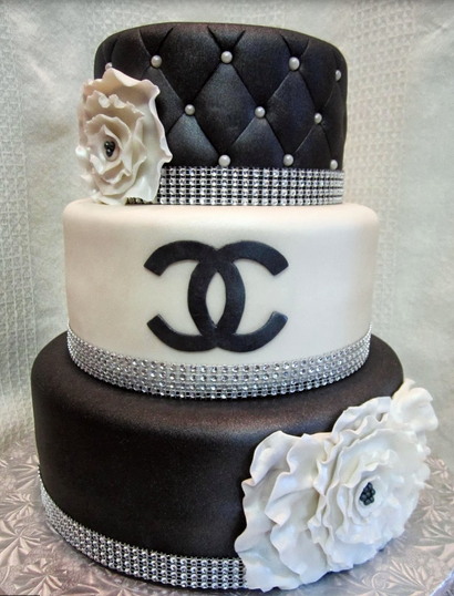 Black and white Chanel wedding cake with flowers and crystal cake decor.PNG