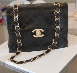 Black Chanel purse cake with gold chains.PNG