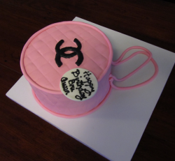 Pink Chanel purse cake with black Chanel logo perfect for birthday parties.PNG