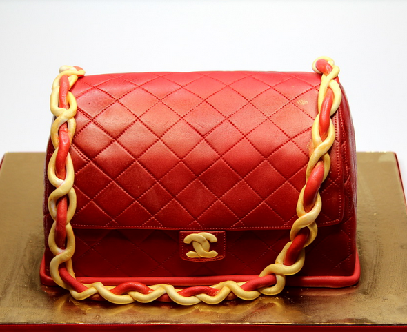 Red Chanel purse with gold strap cake with gold Chanel logo.PNG