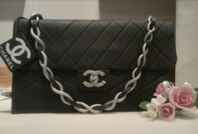 Black leather Chanel handbag with gold strap cake image.PNG