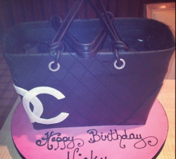 Chanel tote cake in black with white Chanel logo.PNG