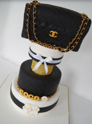 Coco Chanel cakes wit large black leather Chanel.PNG
