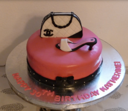 Designer handbag cake picture of pink Chanel cake with cute Chanel purse cake topper and Chanel shoe cake topper.PNG