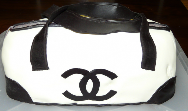 Large white and black Chanel handbag with black Chanel logo.PNG