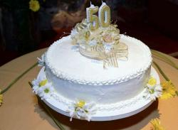 50th Round White Birthday Cake with Candle Depicting Age.JPG