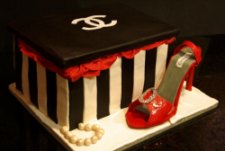 Black and white Chanel shoes box with red Chanel shoes cake with pearls.PNG
