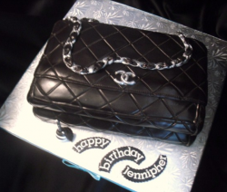 Black Chanel handbag cake with silver chain strap.PNG