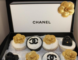 Elegant Chanel cupcakes with black Chanel logo, black Chanel purse cupcake topper and gold flowers cupcake toppers.PNG