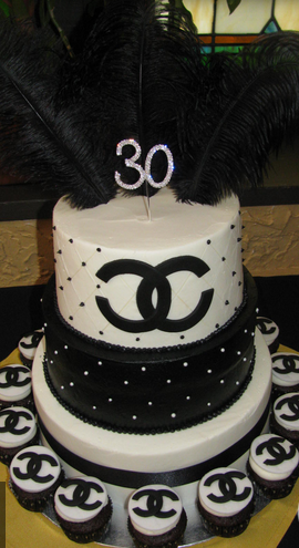 Large two tiers black and white Chanel birthday cake with Chanel cupcakes.PNG