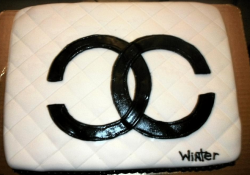 White square Chanel cake with large black Chanel logo.PNG