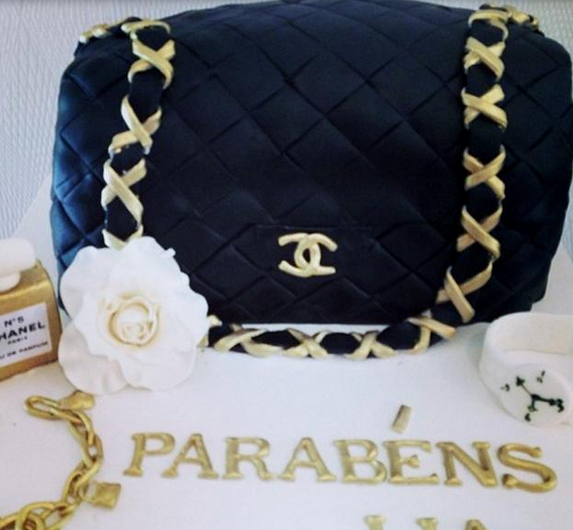 Classic Chanel handbag cake with gold chain strap.PNG