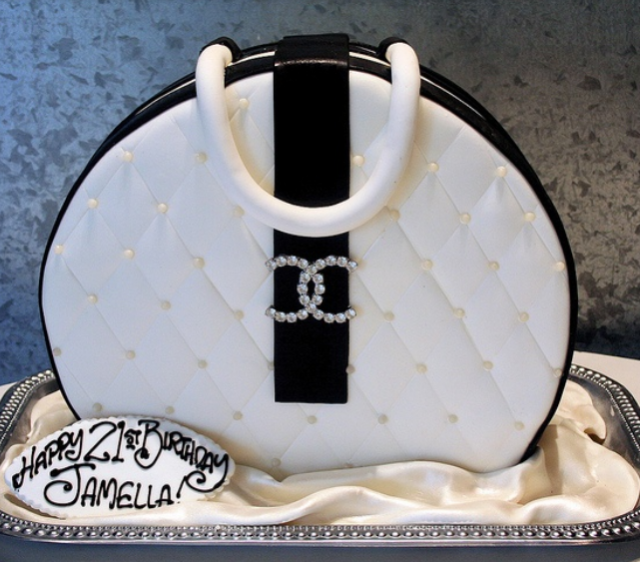 Elegant fancy Chanel handbag cake in white with black touch and crystal Chanel logo.PNG