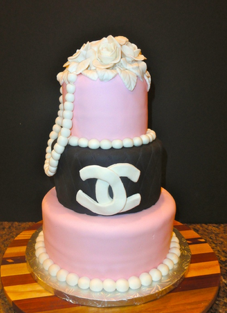 Newest style Chanel birthday cake with three tiers and flowers cake topper and pearls cake decor.PNG