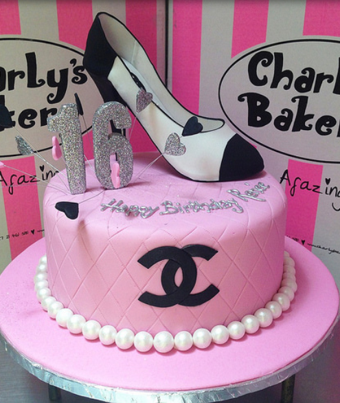 16 birthday cake in pink with white and black Chanel shoe cake topper and pearl cake decor.PNG