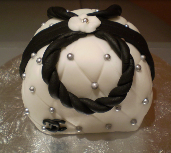Unique Chanel purse cake with silver pearls.PNG