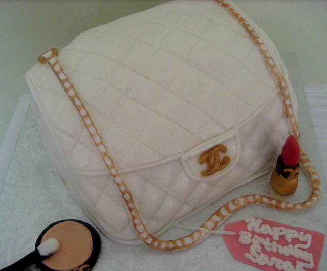 White Chanel handbag with gold chain strap with makeup birthday cake.PNG