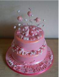 Bright pink christening cake with fun topper