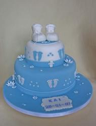 Blue and white Chirstening cake with baby shoes