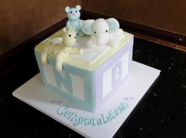 Baby Shaped Cake Images : Baby Shower Cake in Shape of Cube with Cute Animals on Top ...