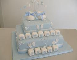 Baby blue christening cake with baby shoes topper with white letter cubes