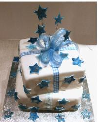 White Christening cake with blue stars