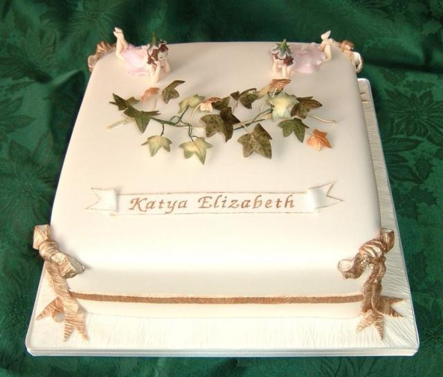Single square Christening cake with floral topper