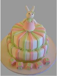 Colorful Christening cake with rabit topper