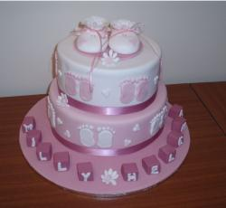 Pictures of White and pink Christening cake with baby shoes topper