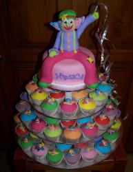 Colorful Christening cake with a clown topper