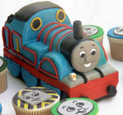 Thomas the train cake with cupcakes pictures.PNG