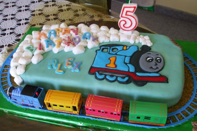 ... Thomas the train birthday cake with cute Thomas theme cake decor.PNG