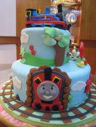 Cute Thomas and friends birthday cakes with cool kids cake decoration.PNG