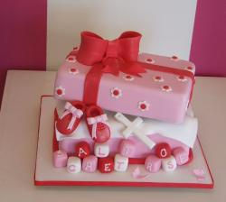 Pink and white gift box christening cake photos