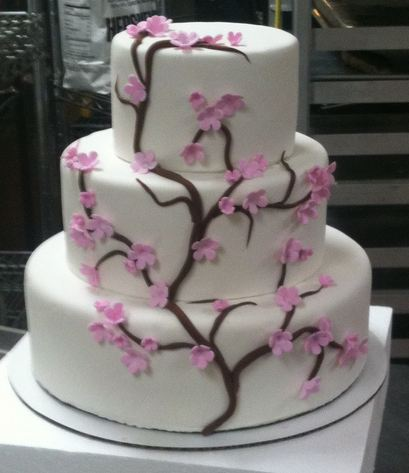 Three tier white wedding cake with cherry blossom tree.JPG