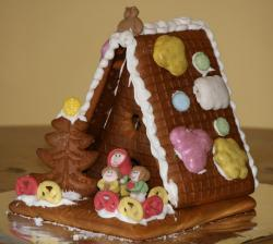Christmas holiday theme ginger bread shack cake with revelers.JPG