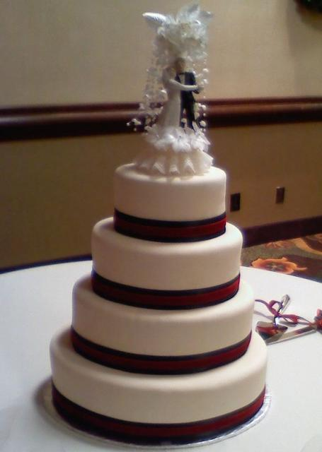 red and white wedding cake toppers four tier white wedding cake with and groom topper 19106