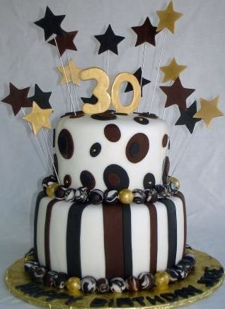 Two tier thirtieth birthday cake in chocolate and white with stars.JPG