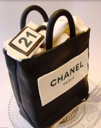 Black Chanel shopping bag cake photos.PNG