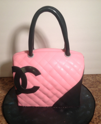 Chanel black pink cake with large Chanel logo.PNG