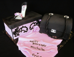 Elegant Chanel theme cakes with Chanel lambskin handbag and Chanel shoe on top of the shoes box.PNG