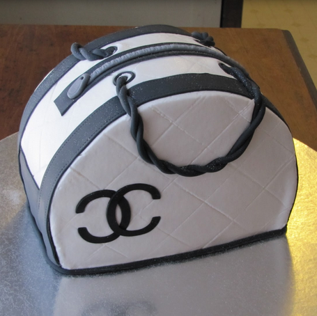 White Chanel cake with black patterns with black Chanel logo.PNG