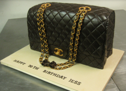 Black Chanel Caviar handbag with gold chain.PNG