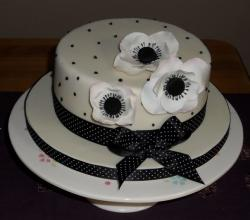 Fancy cake in white and black with flowers is beautiful cake for mothers day.JPG