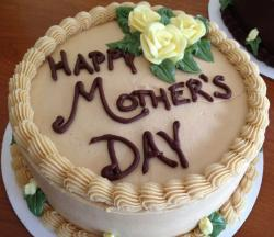 Vanilla mothers day cake with chocolate cake writing with pretty light yellow roses cake decor.JPG